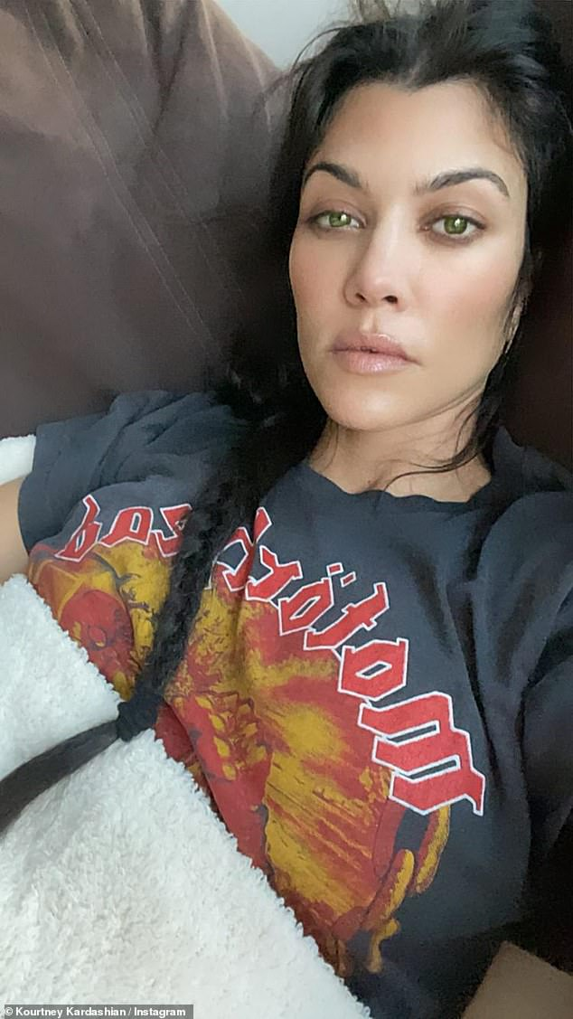 Change up look: Kourtney hasn't shown off the finished look, but has been experimenting with her looks since dating Travis and was recently pictured with green eyes (above)