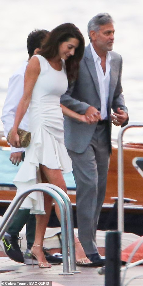 Stepping out: The couple are pictured on July 20 in Lake Como, Italy