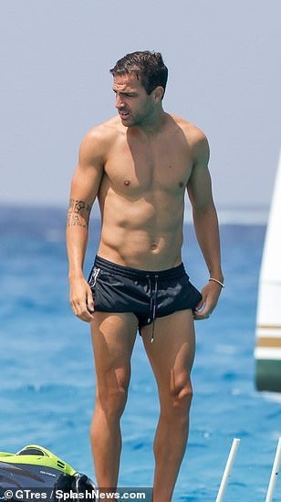 Hunky! Cesc was looking buff as he stepped out on the yacht alongside his family and friends