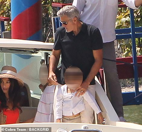 Protective: George held onto his twins while the boat arrived at the restaurant