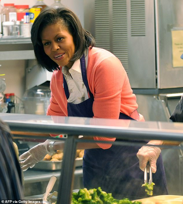 Michelle Obama serves lunch to the homeless at Miriam's Kitchen March 5, 2009