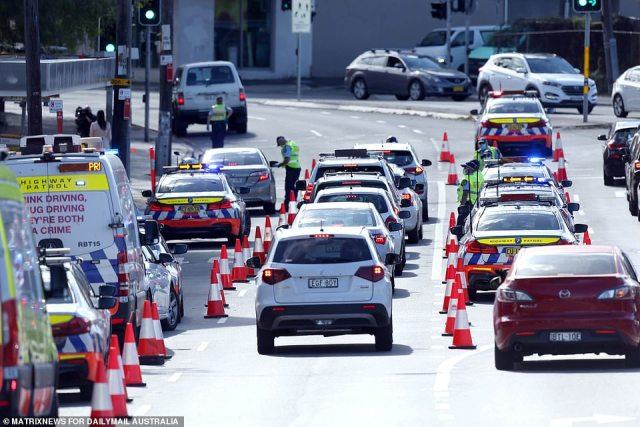 A roadblock in Newton on Saturday as authorities established an exclusion zone around the city (pictured)