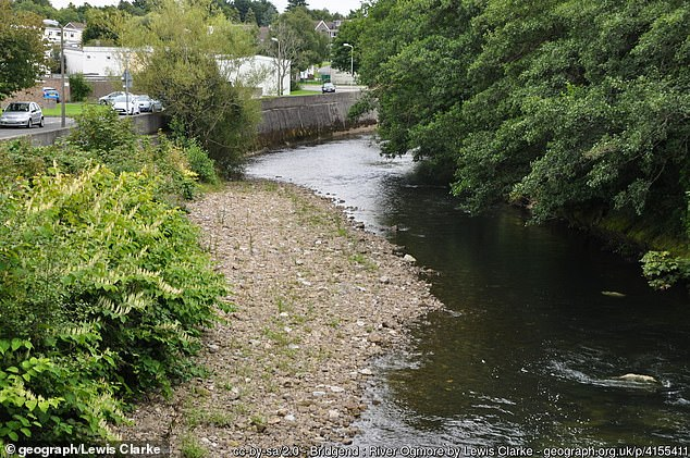 Officers were called at 5.45am today to the Sarn area of Bridgend, south Wales. The boy's body was found in the River Ogmore (pictured)