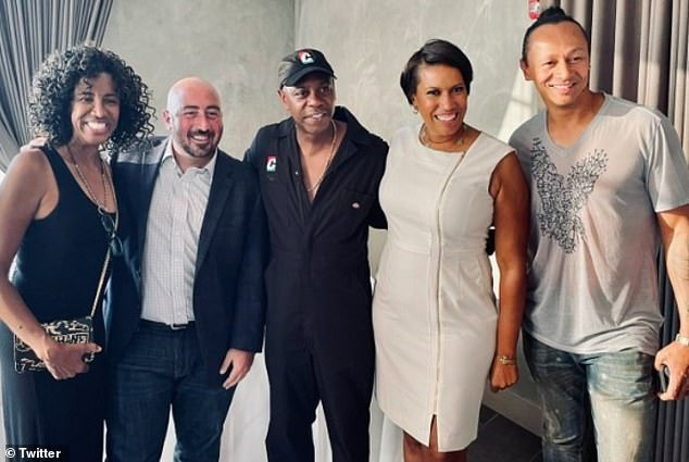 Earlier this weekend Bowser was also criticized for partying on Friday at a separate event (pictured) without a mask just hours before her mandatory face covering order came back into effect. She is pictured second from right alongside Dave Chappelle (center)