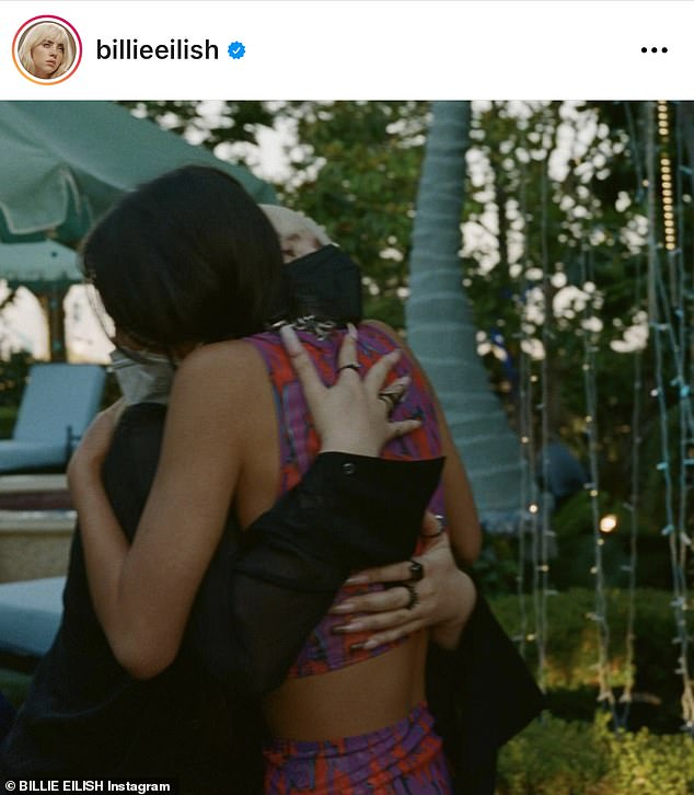 So adorable: She also uploaded several photos of herself hugging her guests, including fellow teenage pop star Olivia Rodrigo