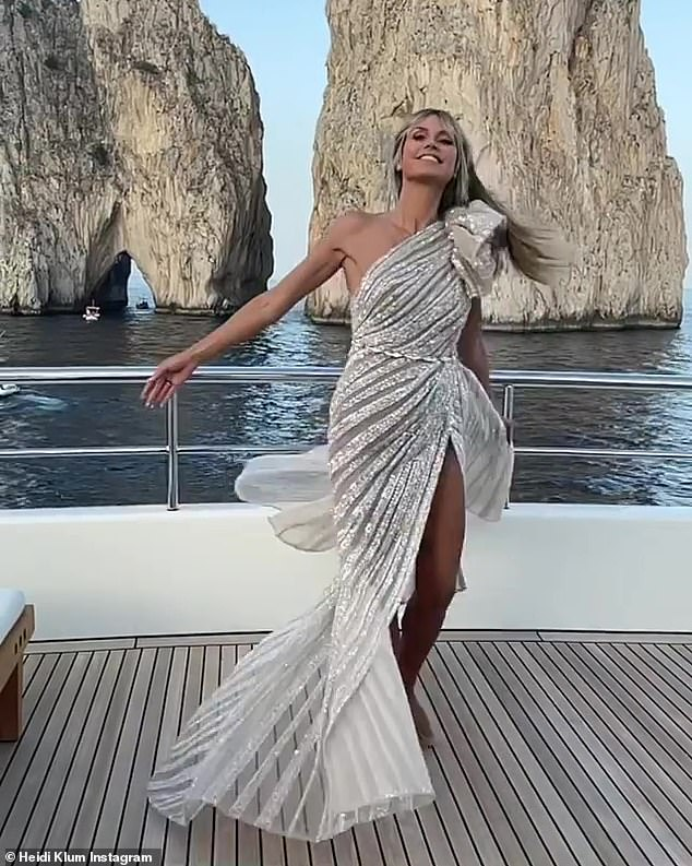 Dazzling: The one-shoulder dress was champagne colored and moved with Heidi as she twirled