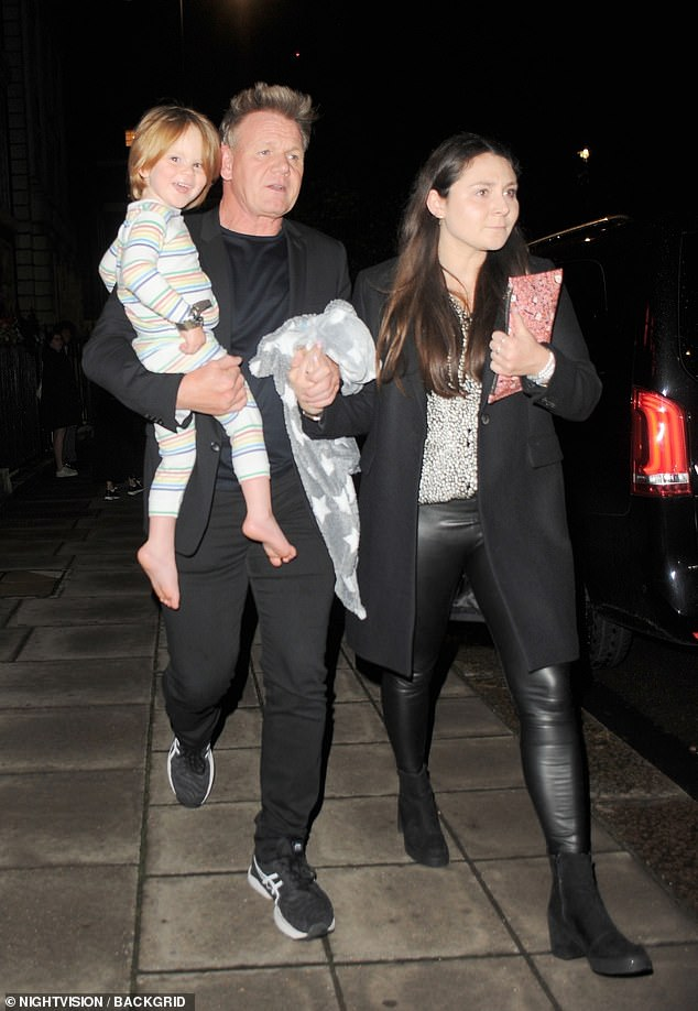 Family time: Gordon Ramsay, 54, stepped out with his son Oscar in his arm and holding hands with his daughter Megan at his restaurant Lucky Cat in Mayfair after going for a meal on Saturday