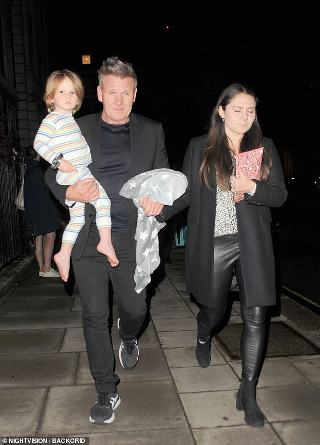 Famous family: Megan looked chic as she left the eatery, wearing pleather leggings, heeled boots, a patterned blouse paired with a black coat