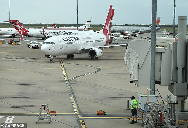 People who were QF2362 at 8.30am on July 28 and QF2365 at 6.40pm on 30 July are being contacted by authorities (pictured: a Qantas flight at Brisbane Airport)