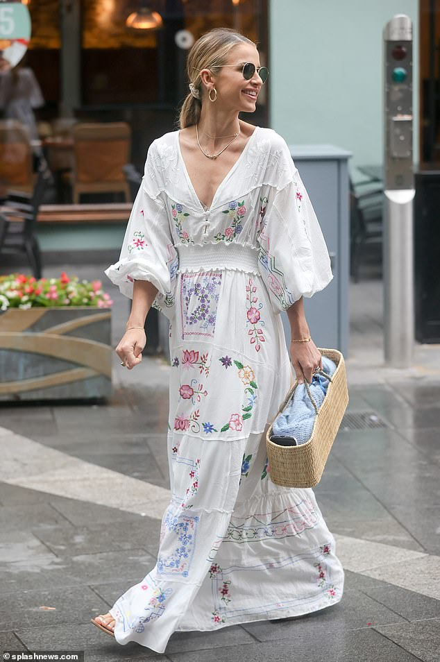 Chic: The presenter, 35, embodied summertime chic in a modern Bohemian, Jaase Semira print maxidress