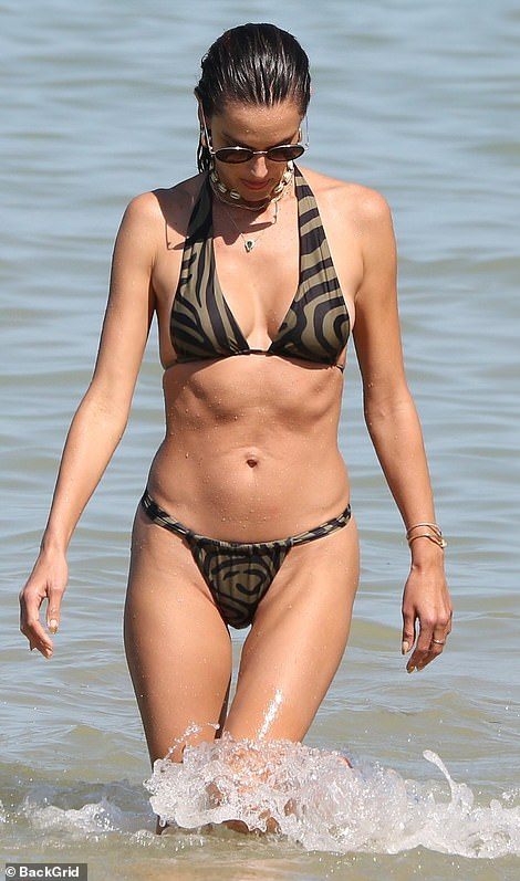 Hot mama: The lingerie model walked in the water alone and looked down