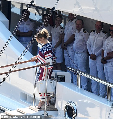 Off she goes: The megastar carried her belongings in a stylish white handbag while walking down the ship's jetty