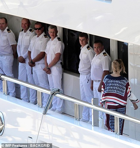 Orderly queue: The yacht's crew lined up to bid the star farewell