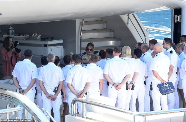 Bidding the crew farewell: JLo took time saying goodbye to the large crew staff at the bottom of a spiral staircase