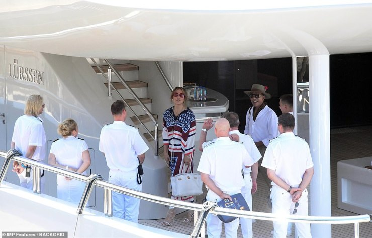 Looking fabulous:The Second Act star wore the same outfit earlier in the day as she disembarked her yacht, and was seen beaming from ear to ear as she bid the crew goodbye