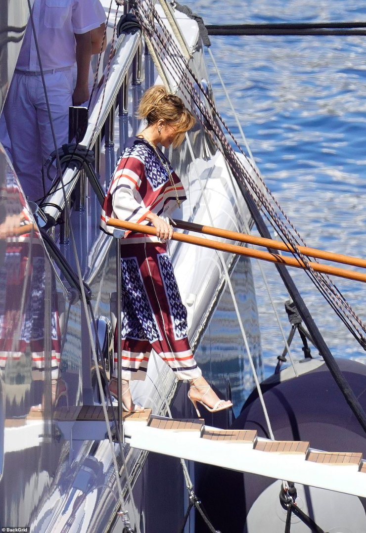 Jennifer Lopez is all smiles as she bids a fond farewell to the crew of her $130M yacht