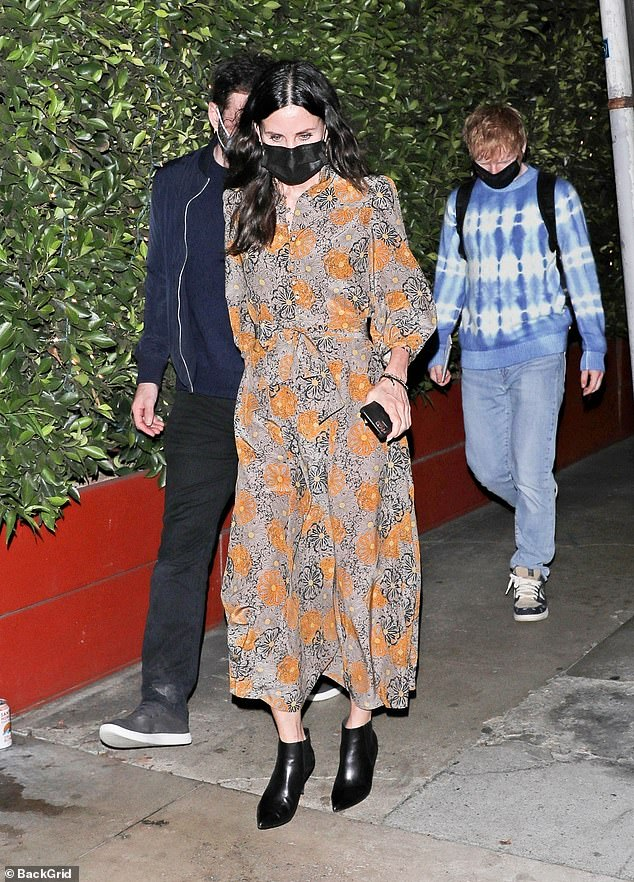 Trio:Courteney Cox looked chic in patterned dress as she enjoyed a dinner in LA with beau Johnny McDaid and her BFF Ed Sheeranin Santa Monica on Saturday