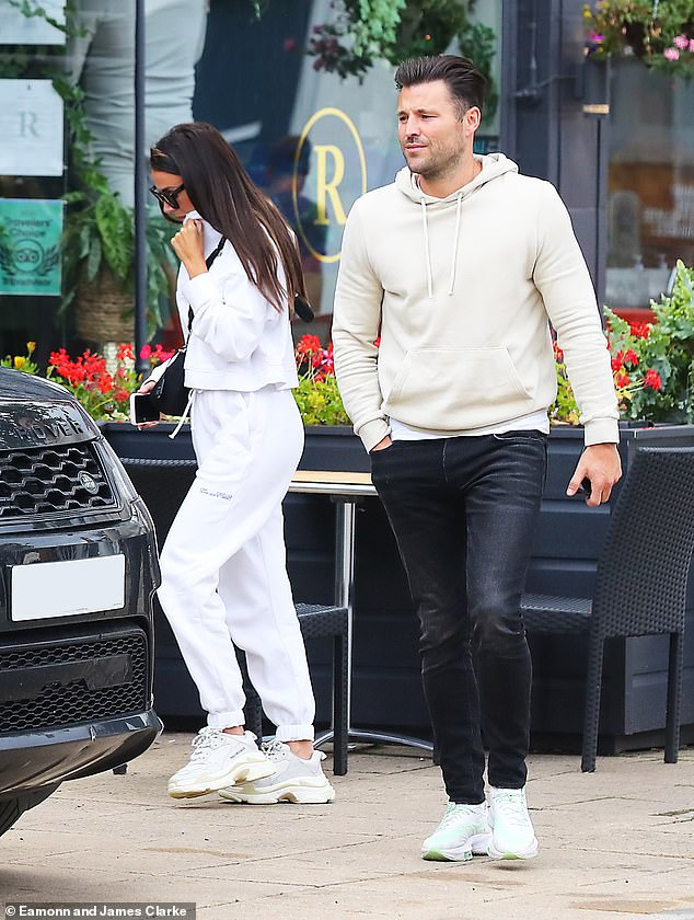 Michelle Keegan dons a white tracksuit as she and husband Mark Wright enjoy lunch in Cheshire