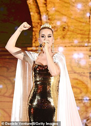 True performer:The performer held her hand up in a fist and pointed out to her adoring fans as she stood centre stage at the show