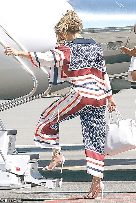 Stylish: J Lo was travelling in style as she donned a chic co-ord