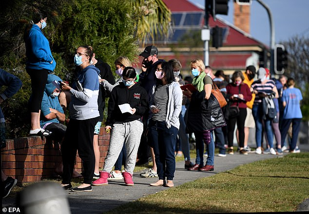 People queue up for a Covid-19 test in Brisbane, Queensland on Monday morning