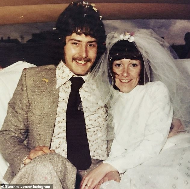 Looking back:In 2019, Suranne has previously reflected on her childhood, describing it as 'a happy, working-class background' (Pictured: Her parents on their wedding day)