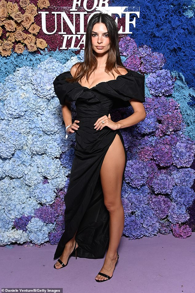 Leggy display:The plunging cut showed her cleavage while adding a touch of drama thanks to the puffball sleeves falling off each shoulder