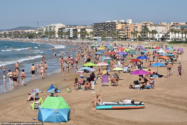Moving a country from amber to red at a moment's notice would force returning travellers to undertake a costly stay in mandatory hotel quarantine. A beach in Tarragona, Spain, is pictured last month