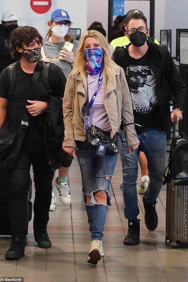 Relaxed: Actress Tara Reid, 45, cut a casual figure as she arrived in Los Angeles' LAX Airport on Sunday
