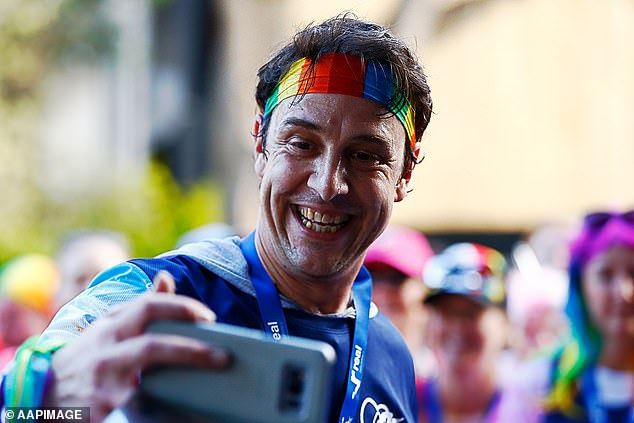 'When you've been hit by a vehicle, little or otherwise, it can take a while to un-wonk yourself,' he wrote on Facebook. Pictured after finishing theLove Your Sister Run in Sydney in July 2018