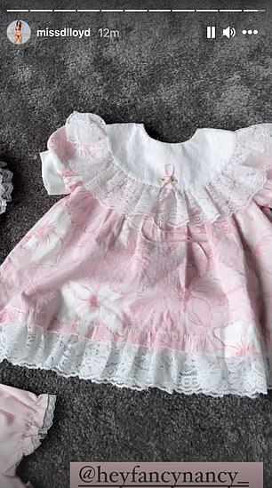 Pretty in pink: An excited Danielle showed off cute pink dresses she's snapped up for her newborn when she arrives in a few months time