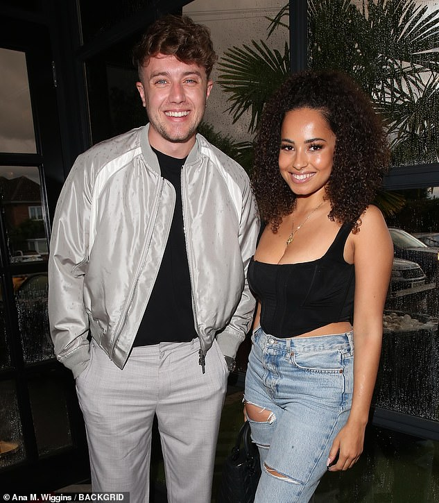 Stopping by: Capital Breakfast radio host Roman Kemp made sure to swing by the launch and was seen posing alongside Amber Gill