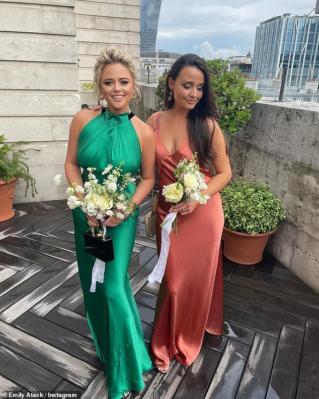 Going green:Emily Atack stunned in an emerald silk dress at her sister's wedding at the weekend [pictured with a fellow guest]