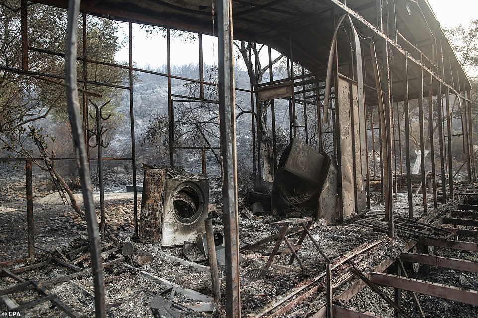 The charred remains of a house are seen inMugla, Turkey, after it was destroyed by wildfires hitting the area