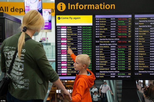Spain and Italy are thought to have been among the countries set for the watch list - a move which industry experts warned could ruin the holiday plans of millions of Britons. Pictured: A mother and her son check the departures at Heathrow Airport today