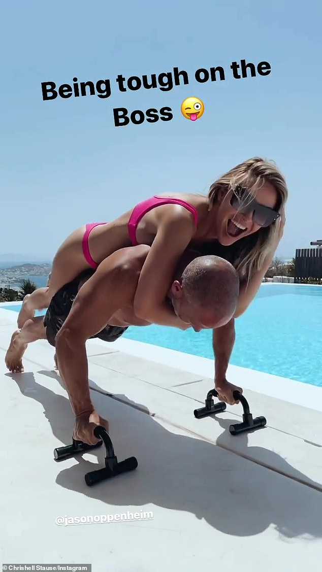 Impressive routine: Chrishell worked up a sweat during a steamy bikini workout as she climbed on top of her boss and beau, Jason, in clips shared to Instagram on Monday morning