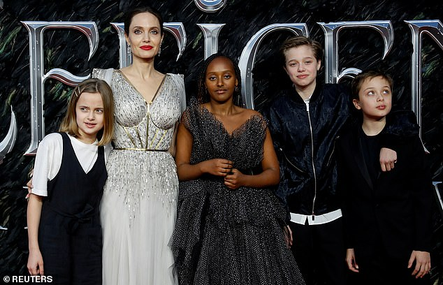 Family matters: Angelina shares her children Zahara, Maddox, 19, Pax, 17, Shiloh, 15, Vivienne, 13, and Knox, 13, with her ex-husband Brad Pitt (pictured 2019)