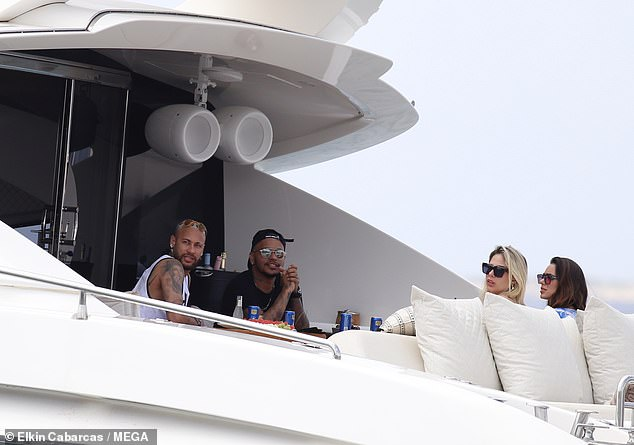 Chilled: The star took in the panoramic views while having a drink with friends