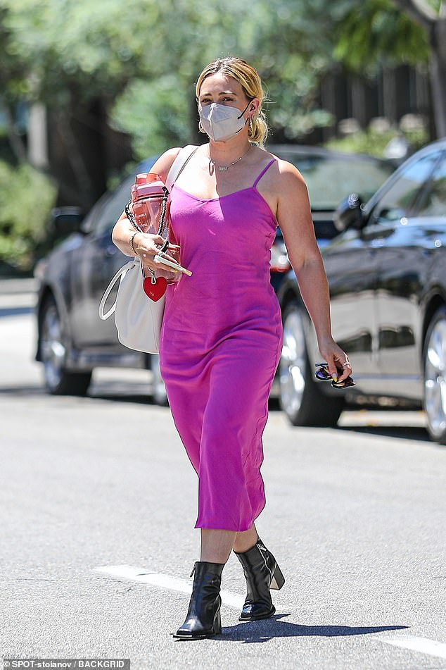 Hands full! Former Disney Channel star Hilary Duff donned a flirty fuchsia frock while running errands in Beverly Hills on Monday