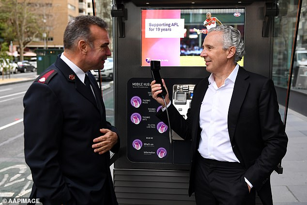 Telstra CEO Andy Penn (pictured right with Salvation Army Major Brendan Nottle left) has announced the telecom companies network of 15,000 payphones will be free for standard national calls and SMS from August 3, and completely coinless by October 1