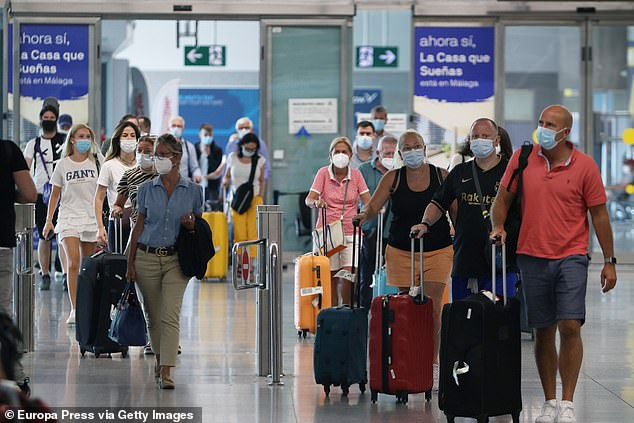 Malaga saw an influx of passengers last week as Spain started to welcome back holidaymakers (pictured, tourists arrive in Malaga on July 19)