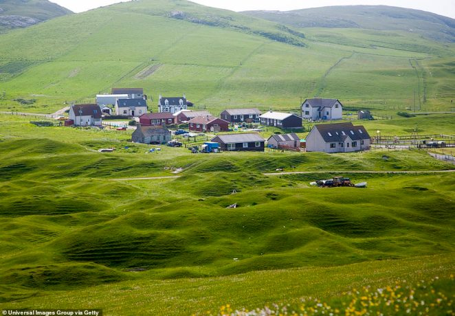 Houses are pictured in the crofting settlement village of Bhatarsaigh, Vatersay, Barra, Scotland. The Scottish government is offering residents and outsiders up to£50,000 to help keep its islands populated