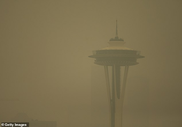 Long-term exposure to air pollution can drive up risk of dementia, a new University of Washington study suggests. Pictured: The Seattle Space Needle during wildfire season in September 2020