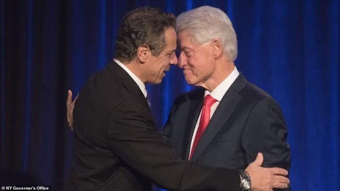 Cuomo unveiled a photo montage on Tuesday showing him hugging and kissing numerous public figures including Bill Clinton, Al Gore, and Al Sharpton