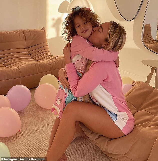 Twinning!The fitness mogul, 26, posted a series of photos of herself embracing her daughter to Instagram
