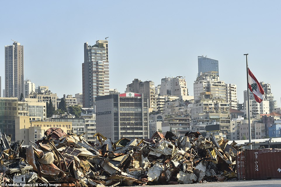 Piles of rubble are seen at Beirut's port against a backdrop of damaged skyscrapers as the country struggles to restore a sense of normality, even a year on from the explosion