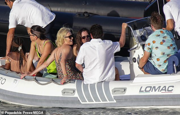 Group outing: Bombshell actress looked happier than ever on vacation