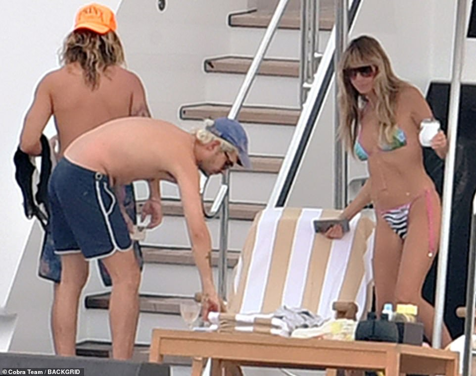 Family fun: Tom's brother Bill enjoyed his time in the sun with the couple