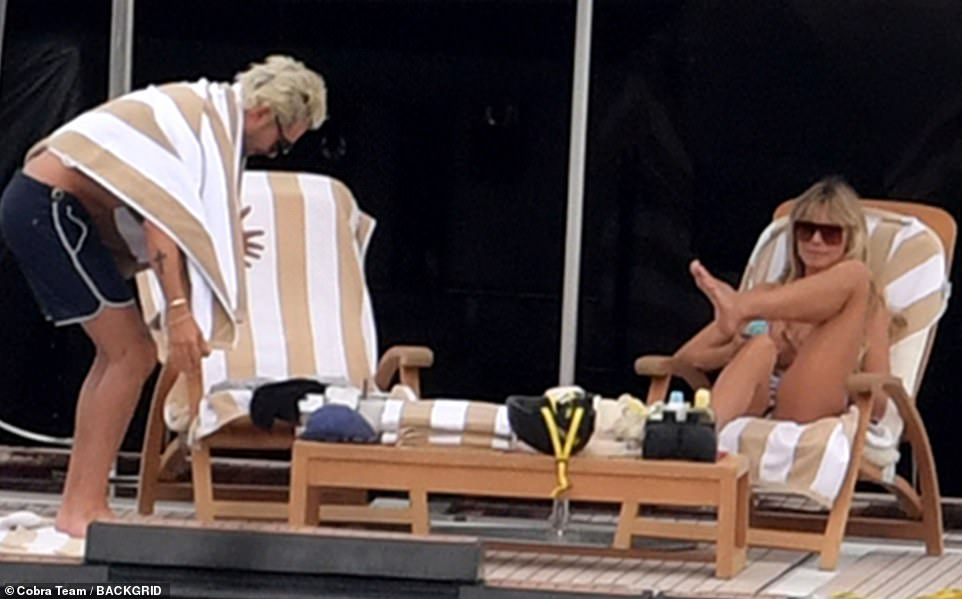 Time to relax: Bill joined Heidi on the wooden lounge chairs