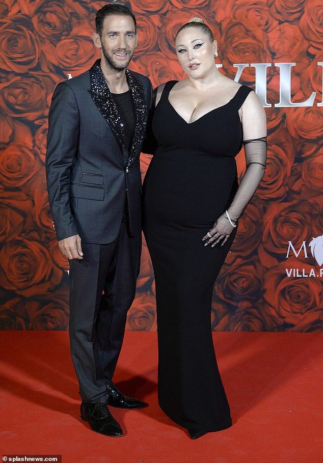 Glam night: Hayley posed with German businessman Marcel Remus, who organized the event